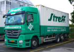 Streff Moving Truck carrying a container 