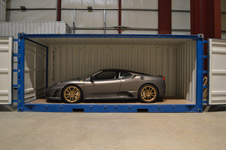 open sided container storing a grey ferrari
