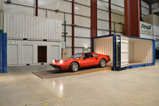 red ferrari loading into safe storage container